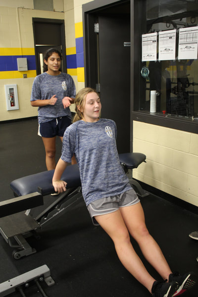 2018 fall girls soccer players weight room action photo